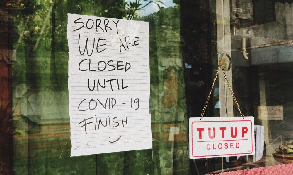 Closed sign in Barbershop door